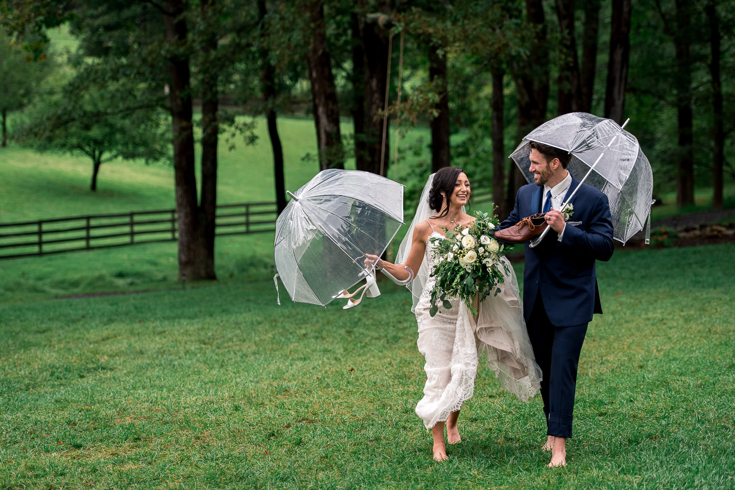 bride and groom walking barefoot in the rain
