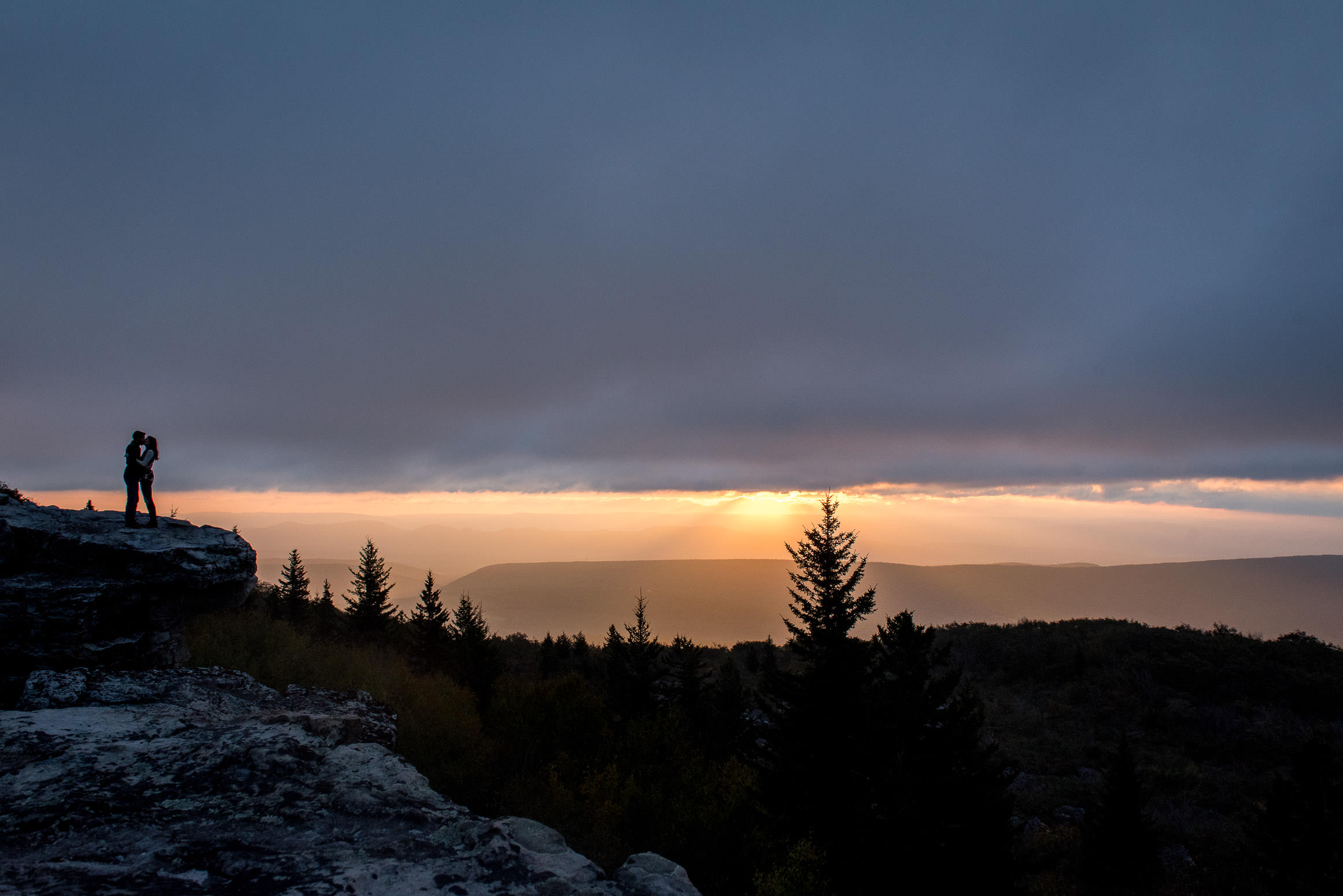 Sunrise engagement adventure in Dolly Sods rocky overlook