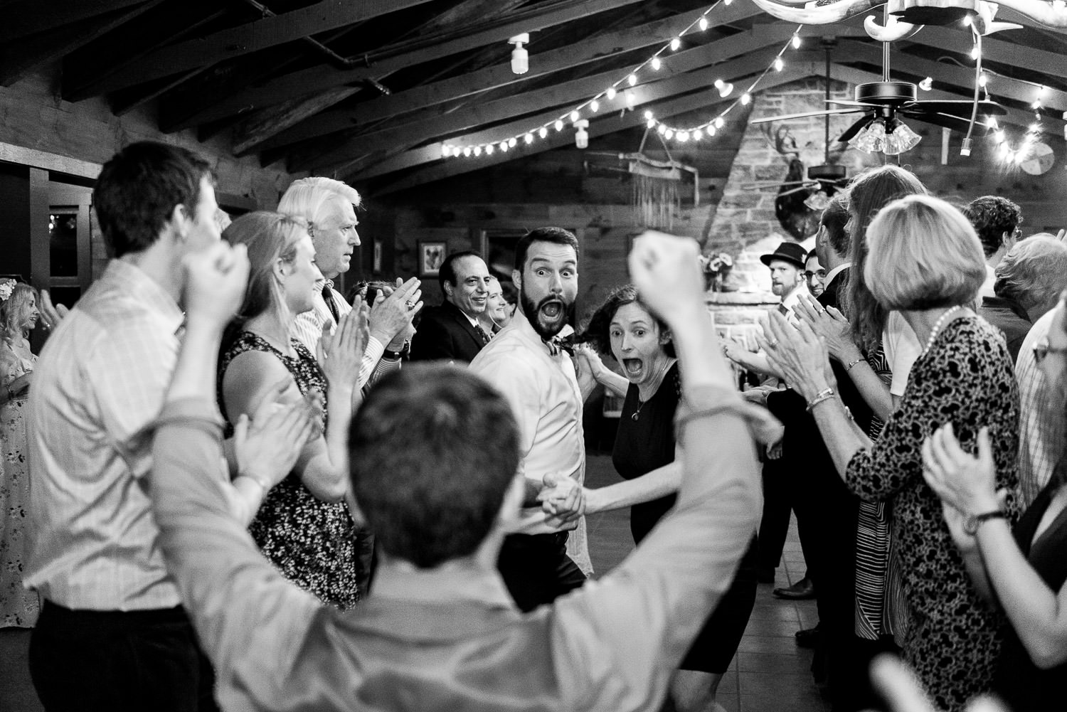 wedding guests participate in contra-dancing and run down line formed by everyone