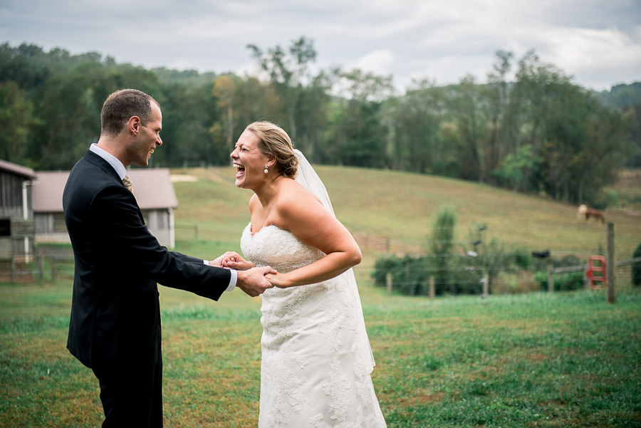 bride beaming after first look with groom