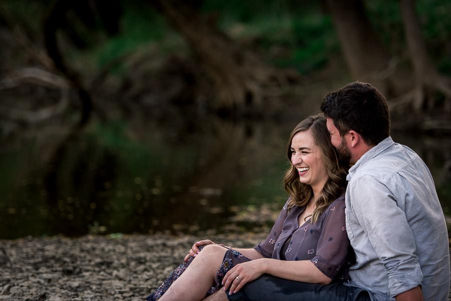guy cuddling girl on Potomac river engagement session