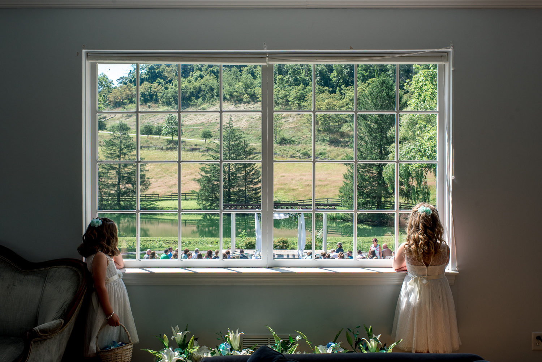 flowergirls peeking out window
