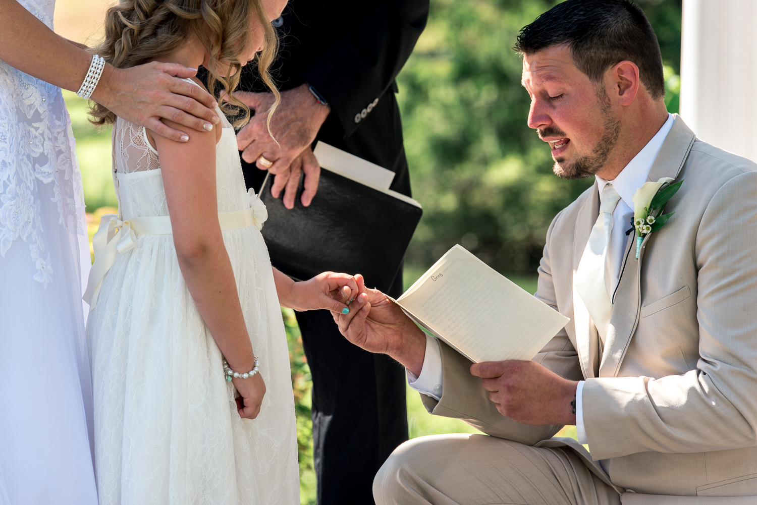 groom reading vows to daughter
