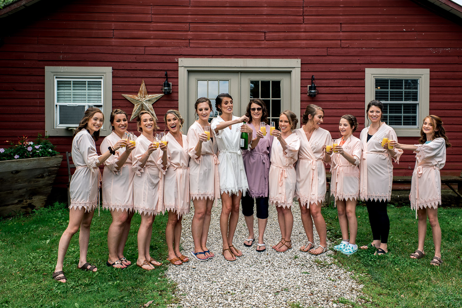 bride and bridesmaids having champagne toast