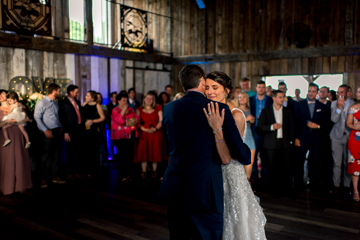 father daughter dance in dim lit barn