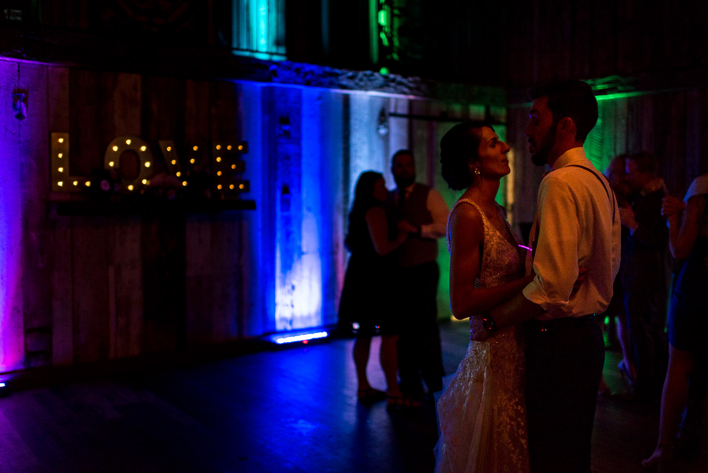 bride and groom dancing together at boho wedding reception