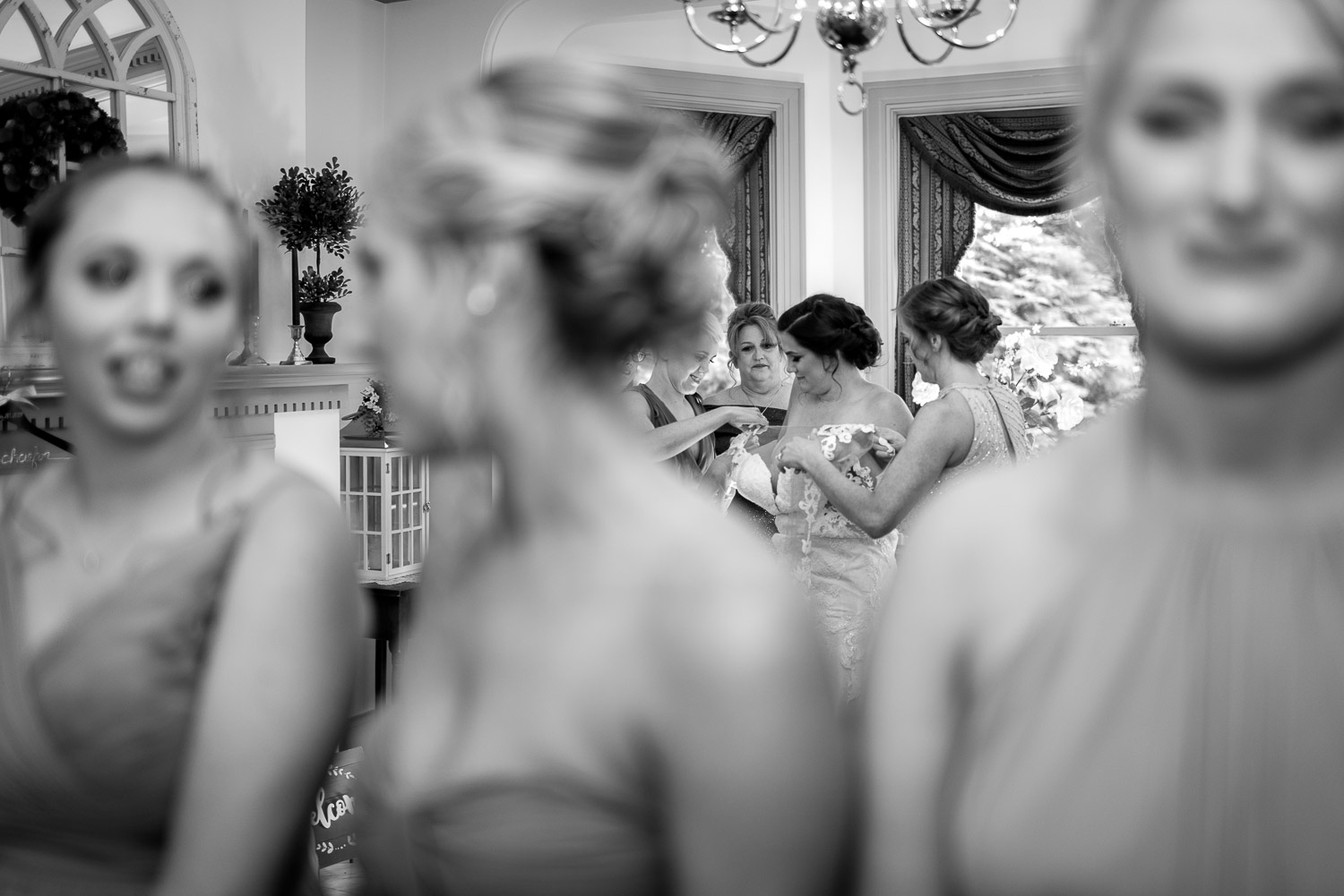 bridemaids seeing bride in wedding dress