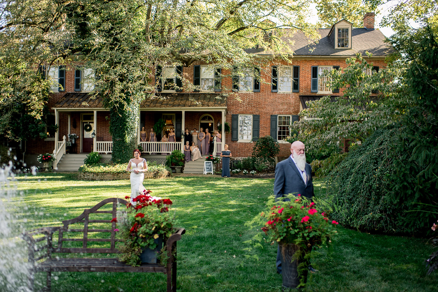 first look with father in front of stone manor inn