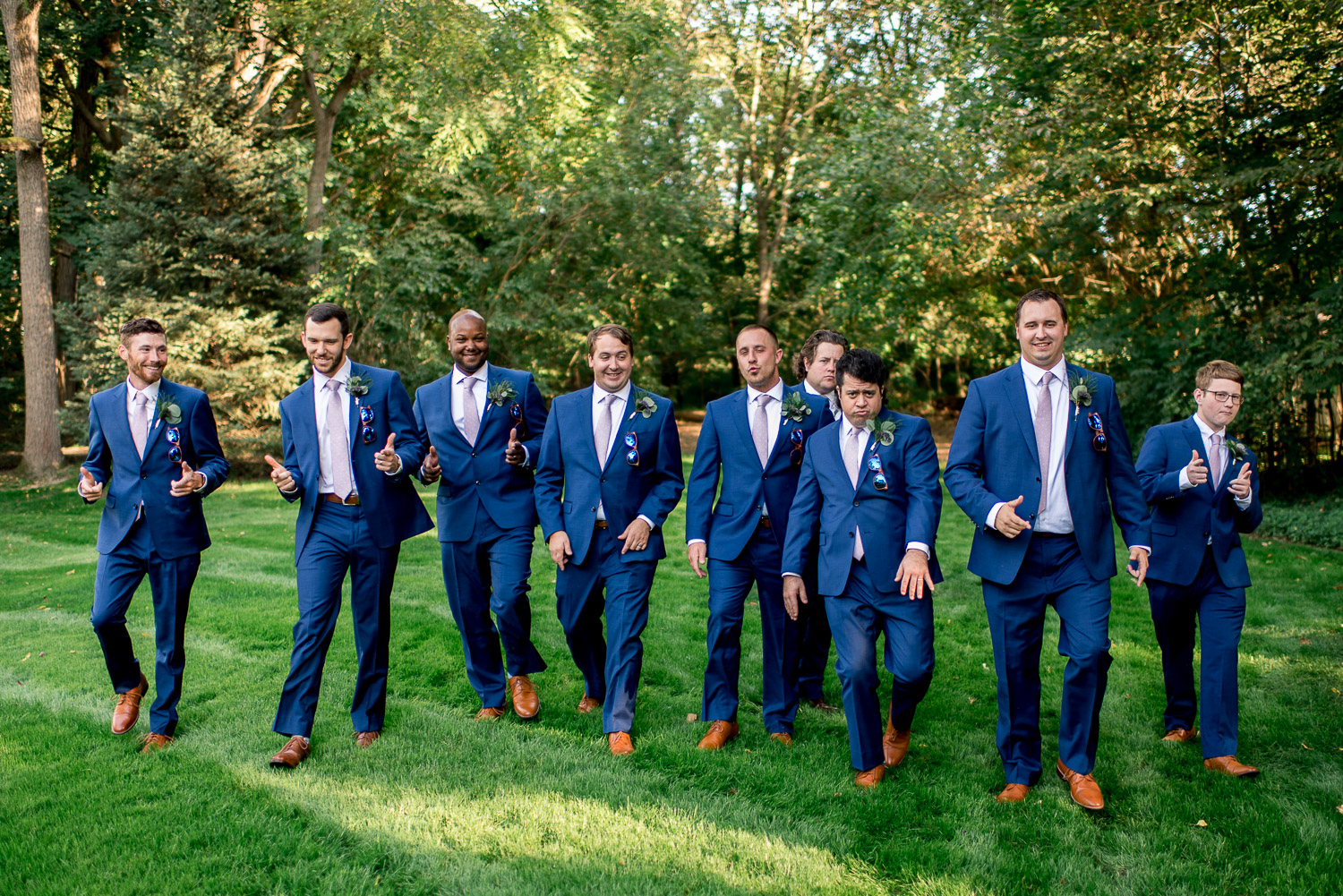 groomsmen walking with groom