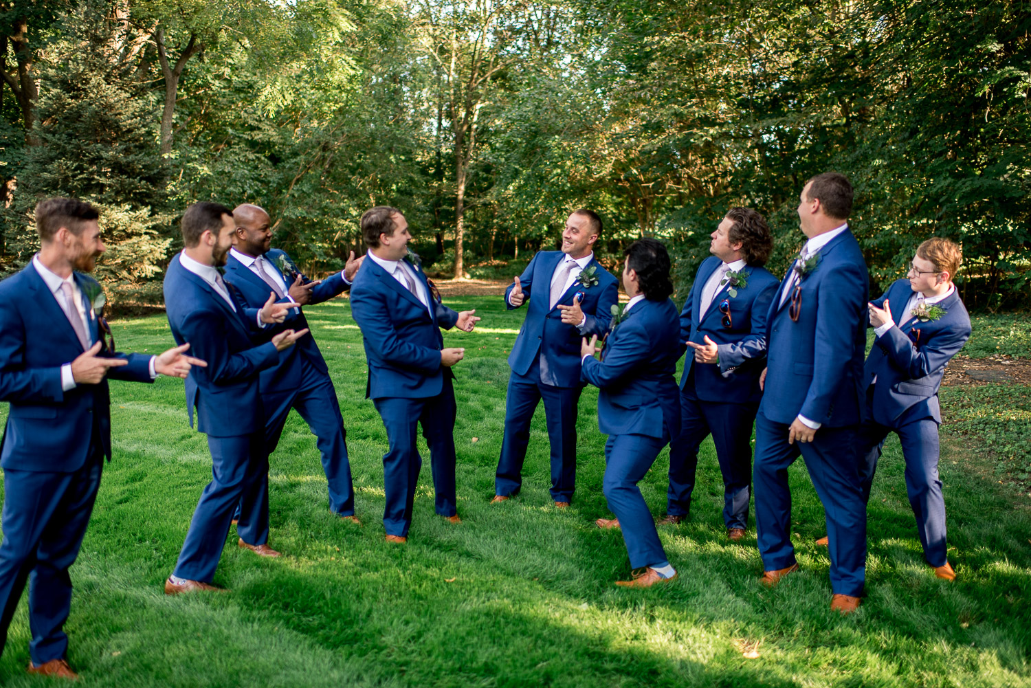 groomsmen being silly with groom