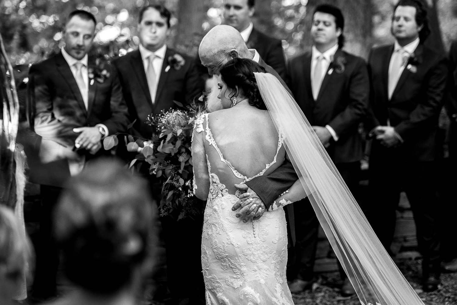 bride walking down aisle with father in forest ceremony
