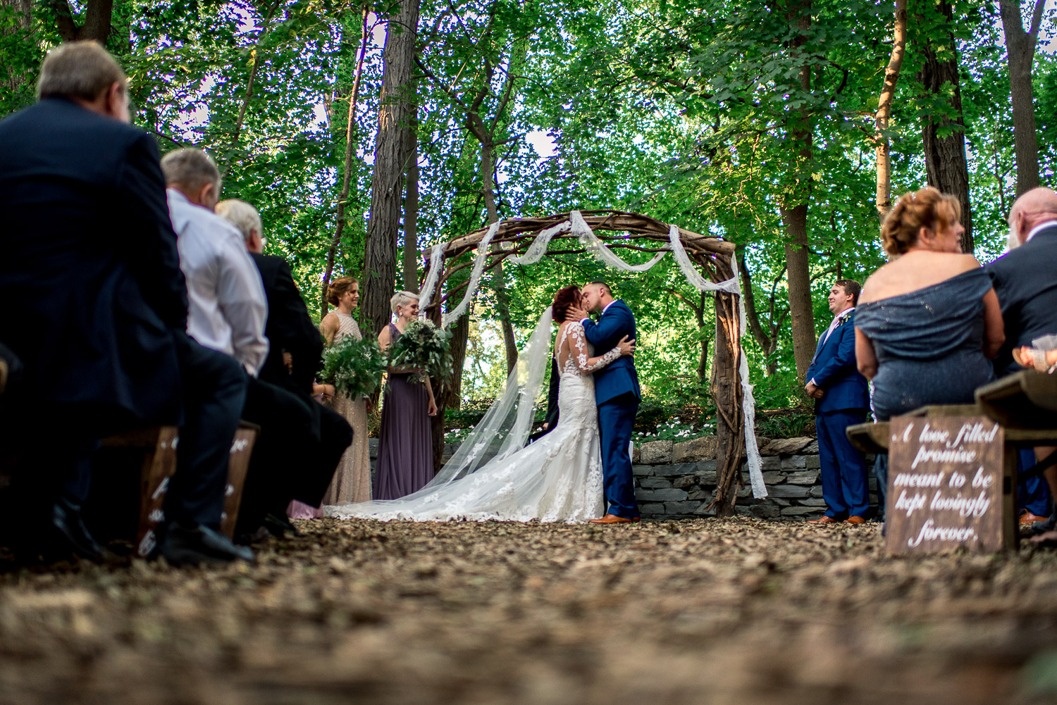 first kiss in forest ceremony site at stone mill inn