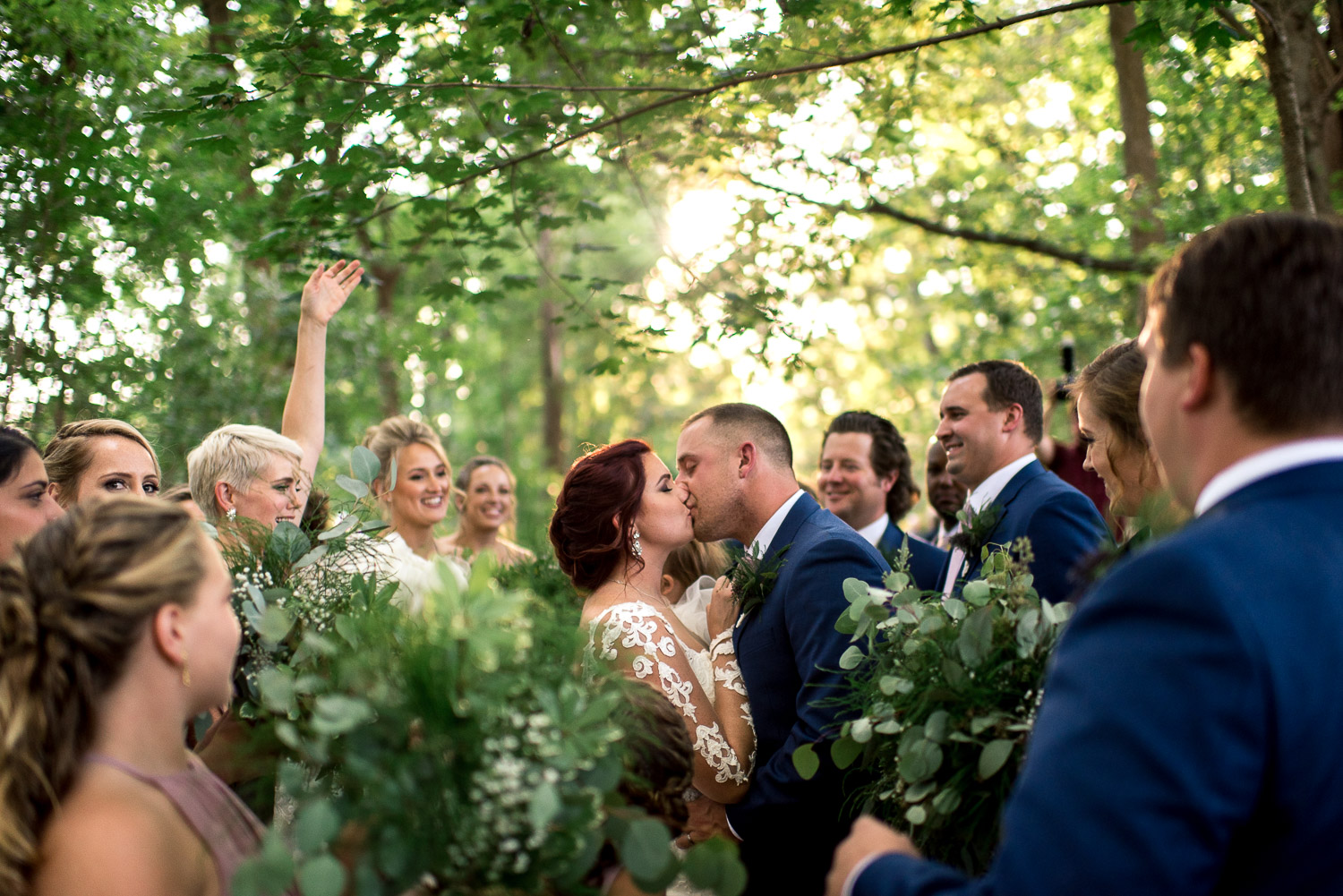 kiss in forest ceremony site at stone mill inn