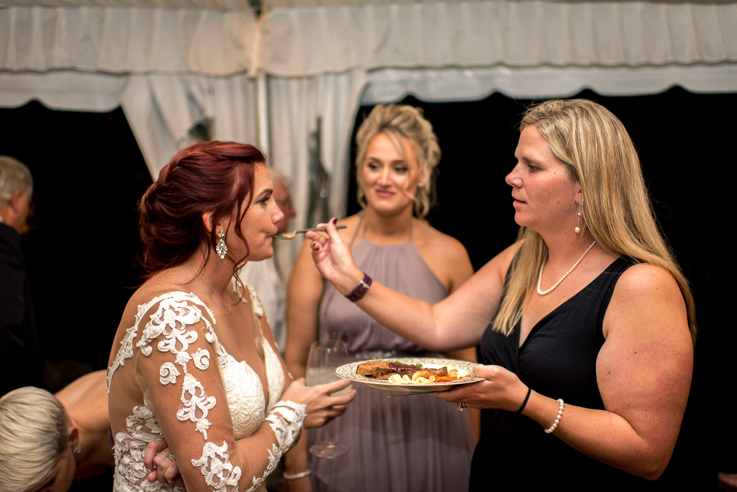 wedding guests feeding bride