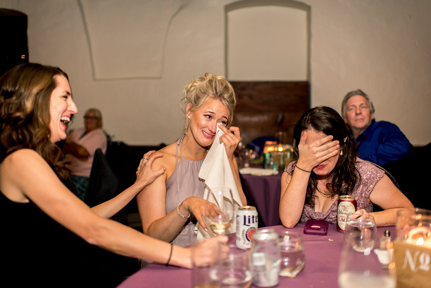 bridemaid crying with laughter at wedding reception