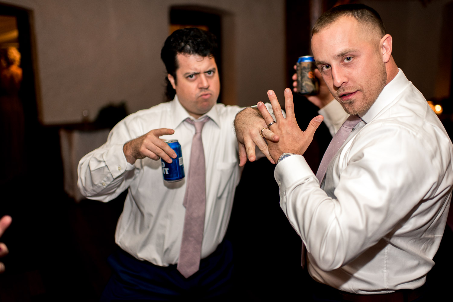 groom and groomsmen showing off rings