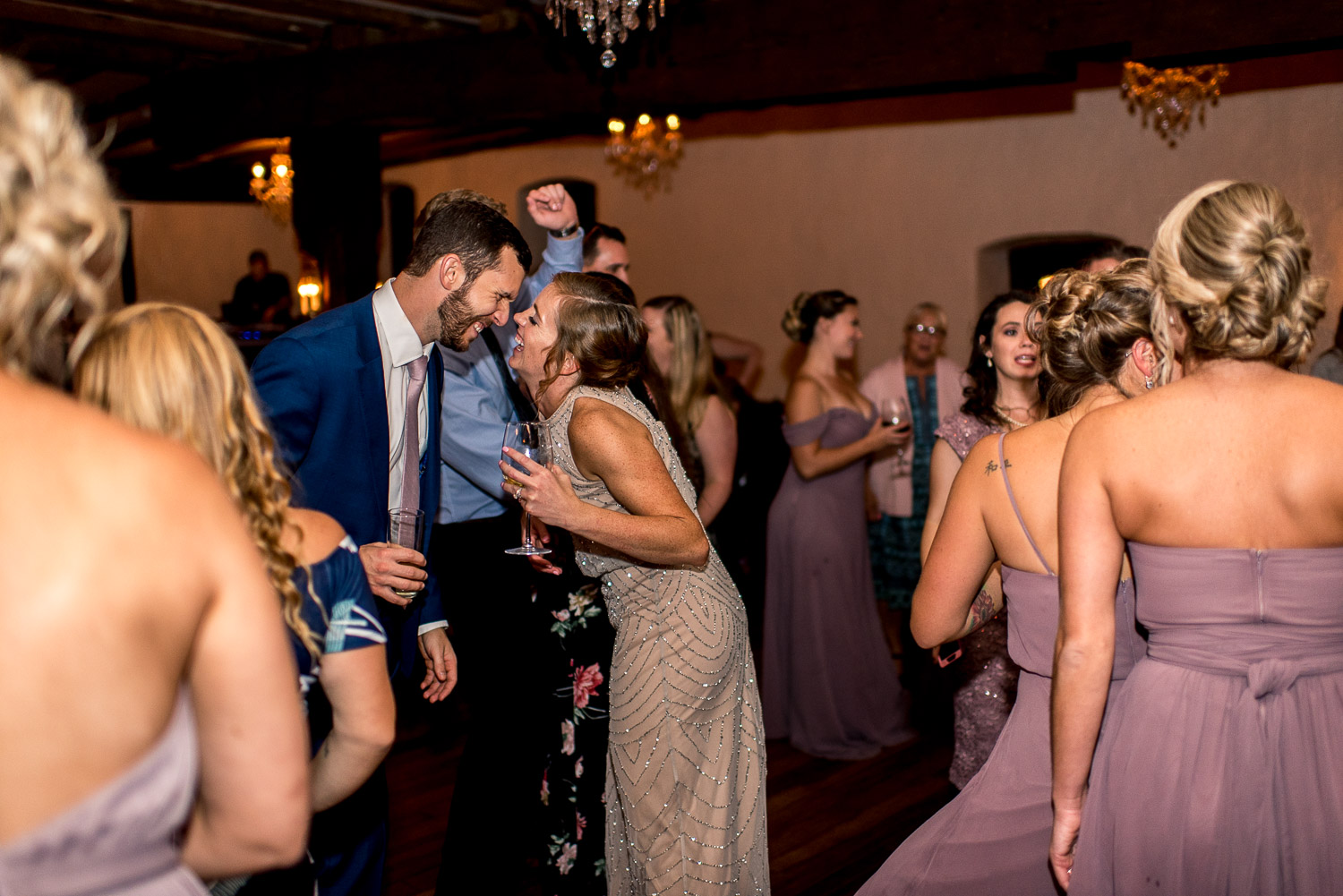 bridesmaid kissing on wedding dance floor