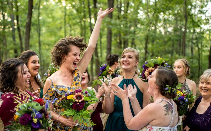 candid moment of bride laughing with bridesmaids