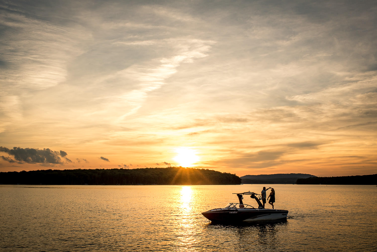sunset engagement session on boat at Deep Creek Lake, Maryland