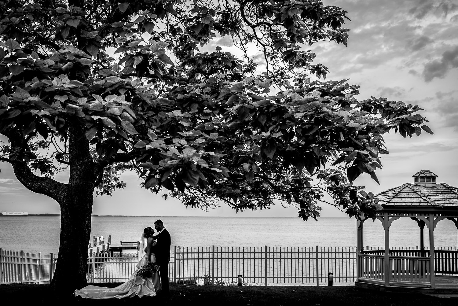 wedding with bride and groom standing on the edge of the Chesapeake Bay in Maryland
