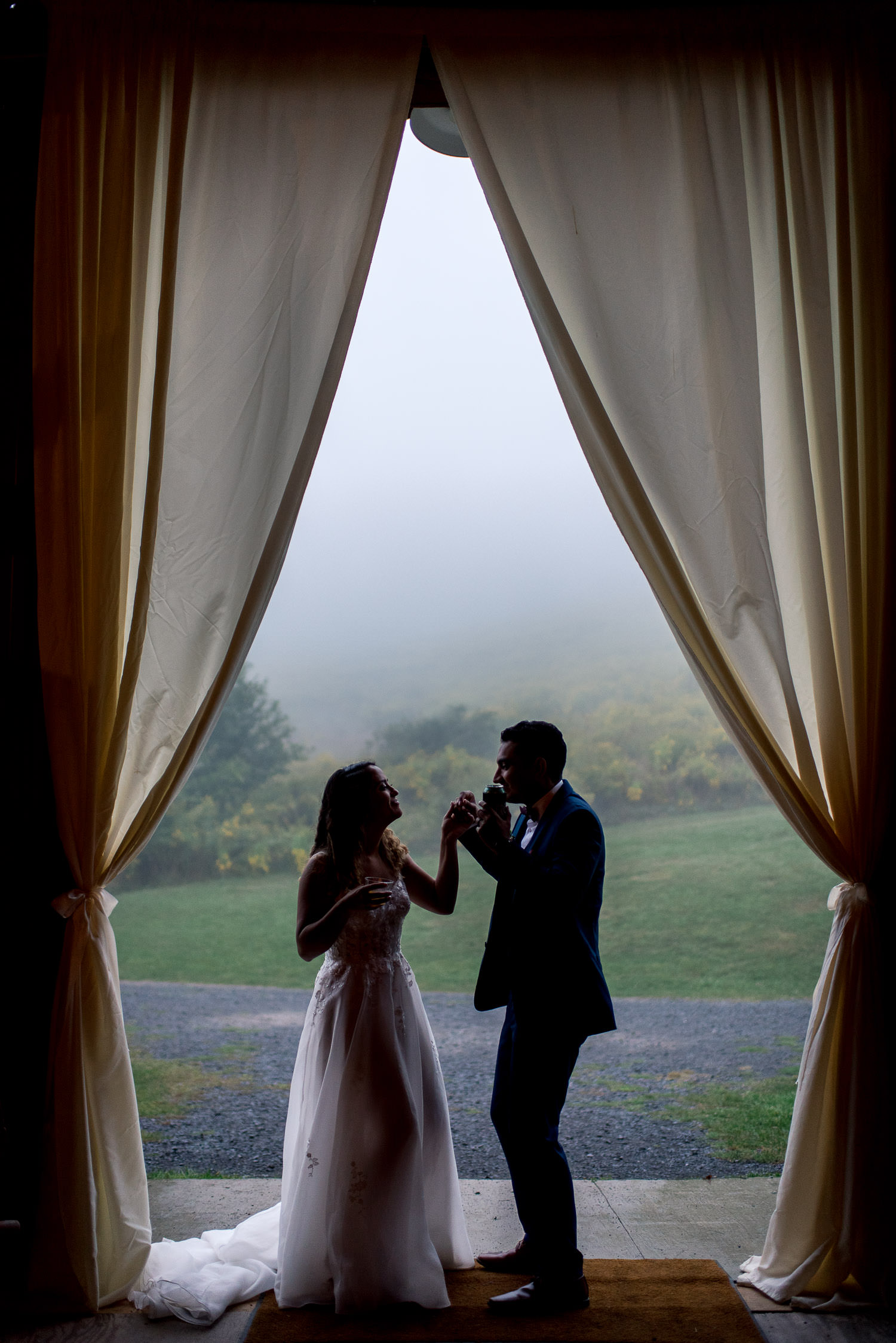 silhouette of bride and groom dancing in doorway