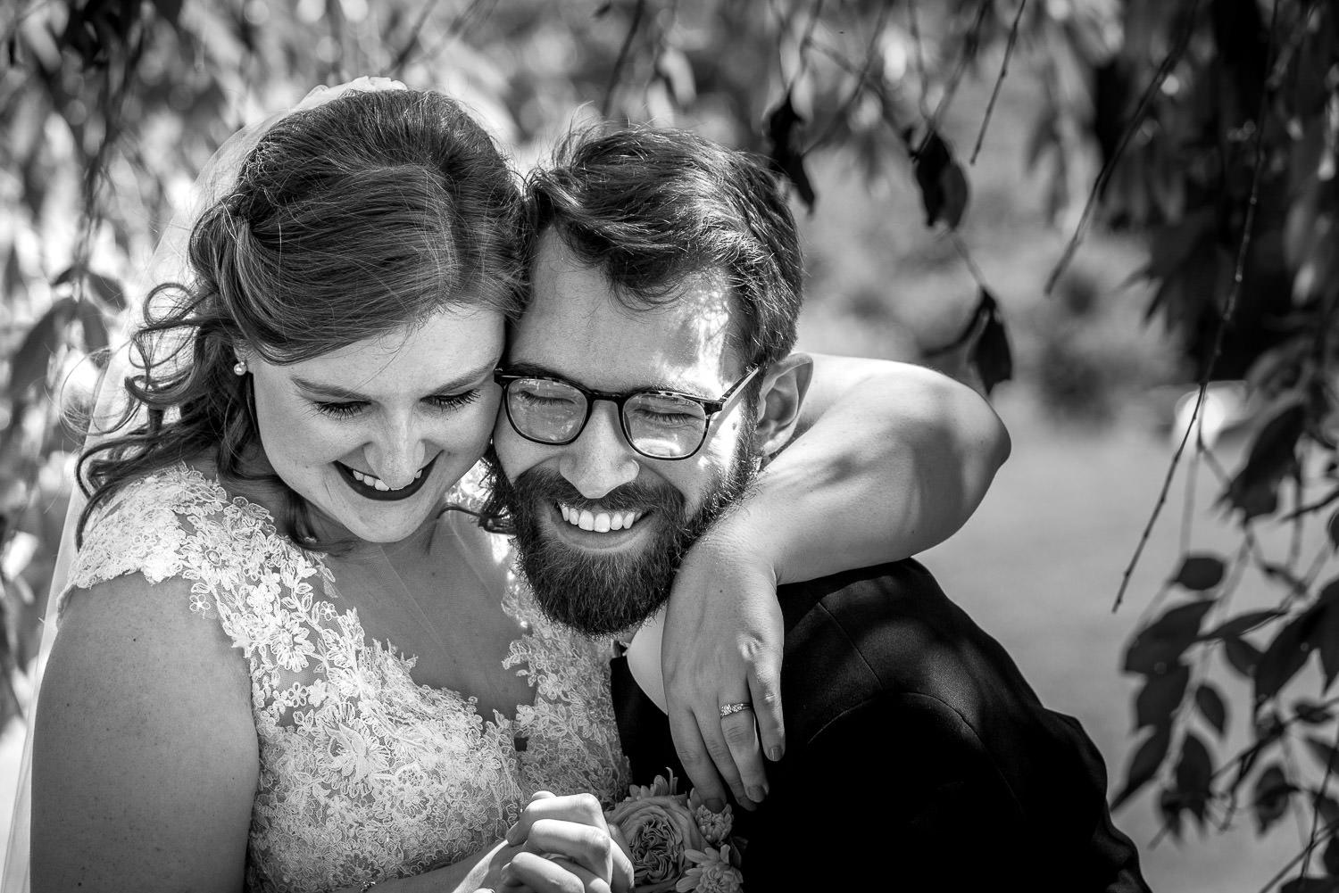 black and white of couple laughing