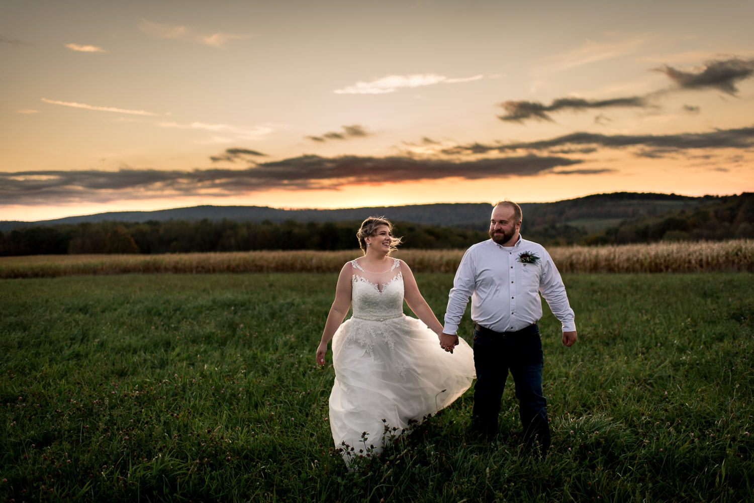 sunset wedding portrait in field