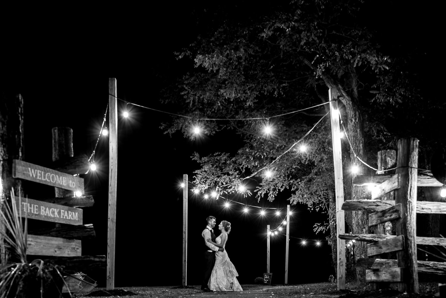 bride and groom posing for night portrait in Deep Creek Lake Maryland