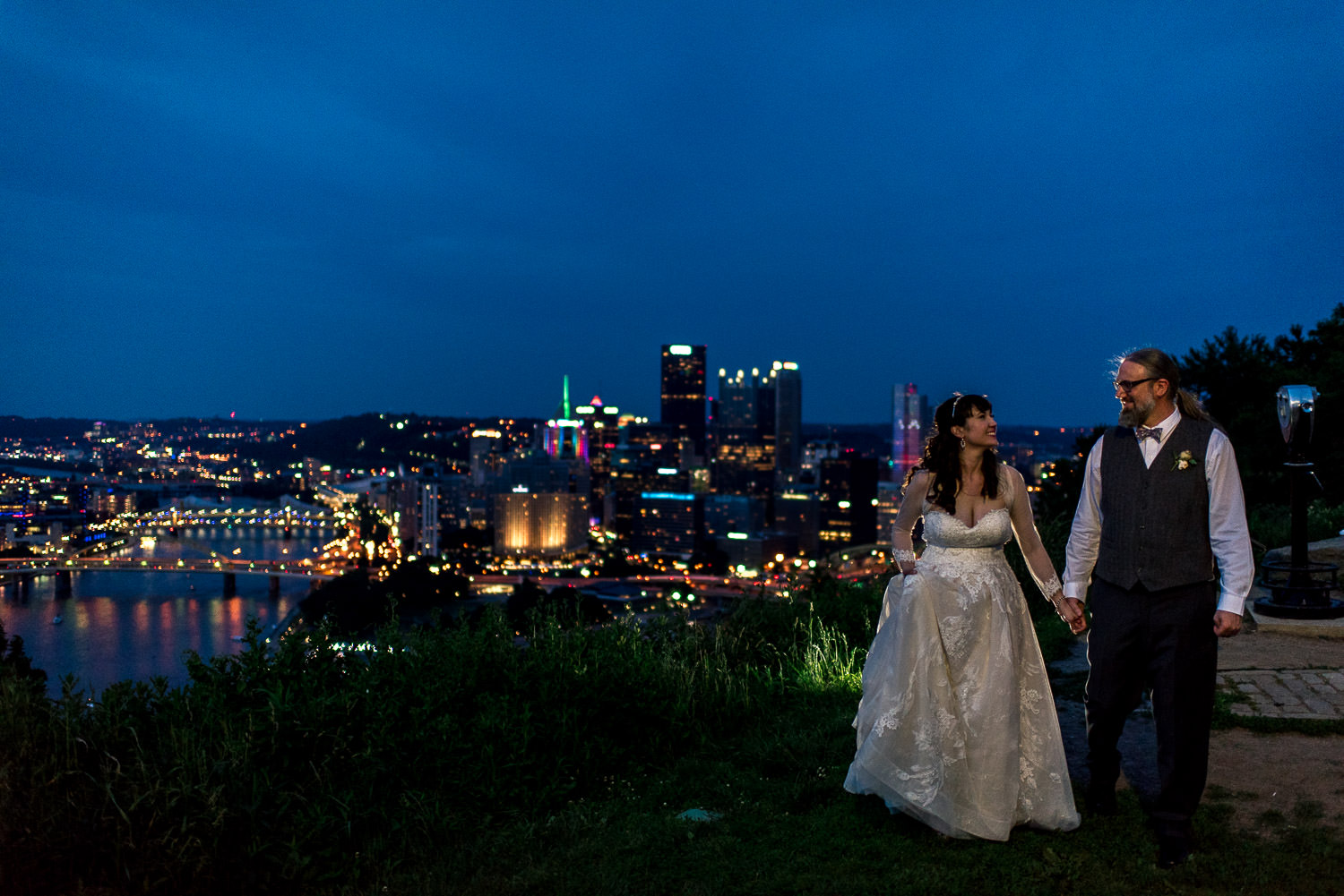 night portrait of bride and groom with city of Pittsburgh in background